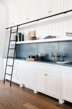 Beautiful Countertops That Aren't White Marble | Soapstone Kitchen Countertop with white cabinetry | The Identite Collective