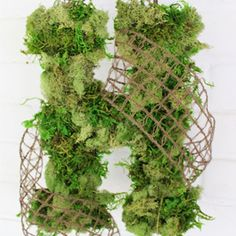 This Moss Covered Monogram is easy to make and chic alternative to a typical front door wreath.