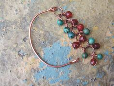 Wire wrapped turquoise and carnelian copper tension bracelet