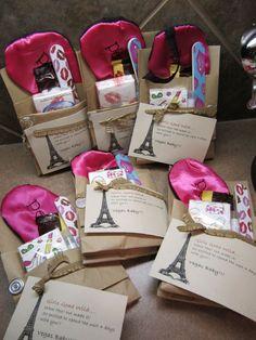 Girls weekend pillow gift--eye pillow, chocolate, a nail file, kleenex, a lip balm, and a wine glass charm. Cute idea