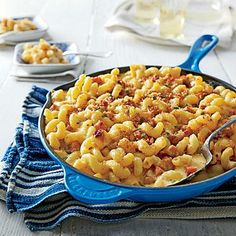 The City and The Country Mac and Cheese | Smoky cubes of brined city ham and salty bits of country ham give this main-course mac its name and savory appeal. Pasta enrobed with a creamy sauce and melting pockets of gooey cheese take it over the top. | SouthernLiving.com