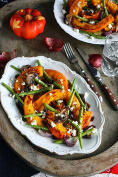 Roasted chili hokkaido squash salad with caramelized red onion, green beans, feta, pepitas and balsamic reduction
