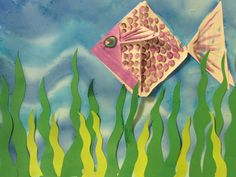 """4th grade origami fish with watercolor background; 8.5"""" X 11"""" ; lesson by art teacher: Susan Joe"""