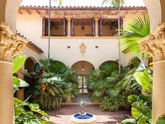 Entrance Courtyard of Jimmy Buffet's former Mediterranean-style Palm Beach estate. This beautiful mansion is soon to be demolished to make way for another mega-mansion...