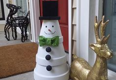Make a Terra Cotta Snowman | Garden Club...hit the side arrow on picture to get the step by step instructions