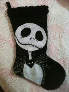 My Friend Made this! Check out her Etsy site! Nightmare before christmas jack skellington inspired christmas stocking hand embroidered felt. $40.00, via Etsy.