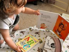 Babies and Board Books. Integrating Play, Learning and Reading.