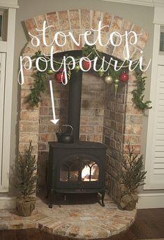 Love the brick surrounding the wood burning stove!