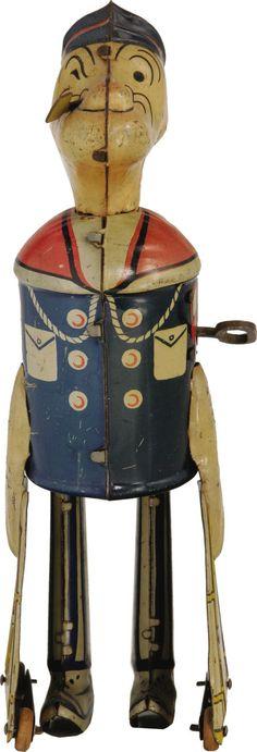 Tin Popeye wind-up toy