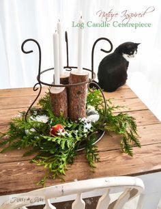 Nature inspired Christmas log candle centrepiece, via http://www.funkyjunkinteriors.net/