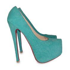 Christian Louboutin turquoise croc pumps....um yes please.