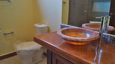 Stone bathroom sink. Hacienda del Rio, Custom retirement homes. Playa del Carmen real estate area.