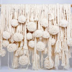 cascade of pom poms and tassels for a window installation by Nikki Gabriel