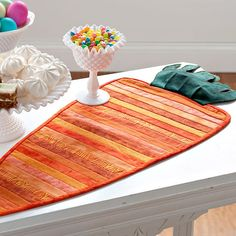 Add something extra to your Easter decor with this DIY carrot table runner. Instructions: http://www.bhg.com/holidays/easter/decorating/quick-and-easy-easter-decorations/?socsrc=bhgpin021413carrotrunner=8