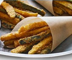 Oven baked Zucchini Fries- parmesan cheese, bread crumbs and 1 egg.  Bake 450, 12-13 minutes.