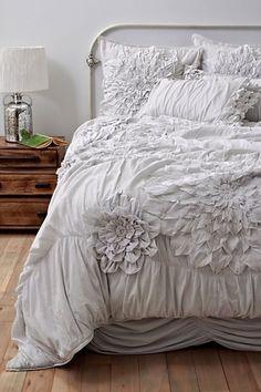 white blooms on gorgeous bedding