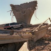 "We who live in earthquake country need to do more to prepare for The Big One. We should be able to sustain ourselves long enough to wait for any help to become available to us. ""Cars lie smashed by the collapsed Interstate 5 connector a few hours after the Northridge earthquake on Jan. 17, 1994, in California."""