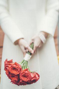 Chic NYC Elopement #redroses #weddingbouquet   http://www.stylemepretty.com/new-york-weddings/new-york-city/2014/09/18/chic-new-york-city-elopement/   Photography: Jimena Roquero - http://www.jimenaroquero.com/