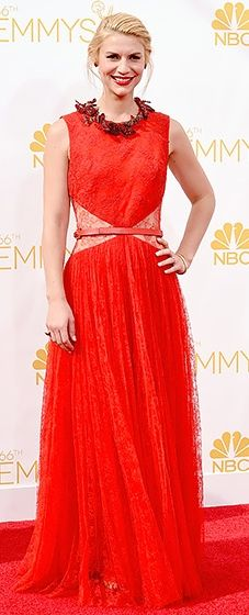 Claire Danes wore a red ensemble by Givenchy featuring a pleated silk lace dress with collar embroidery at the 2014 Emmys.