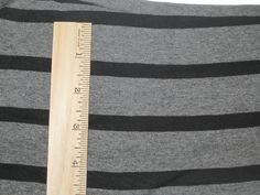Apx 1 1/8 Dark Heather Grey & 3/8 Black Cotton Lycra STripe Knit FAbric.