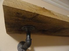 Industrial shelf mounting brackets. Aka pipe fittings....Our bathroom, boards wall to wall.. pipes to match the closet pipes.
