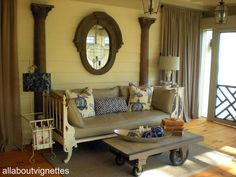 Screened Porch Reveal View One Love the iron sofa.. is that a daybed? and I love the columns
