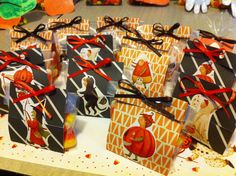 Halloween 2012-matchbook treats for the class. Scrapbook paper, ribbon, stapler, candy corn.