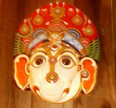 A cheerful Ganesh mask from Nepal is only one of the colorful cultural souvenirs available in Kathmandu. Article at http://www.buckettripper.com/what-to-buy-in-nepal-souvenir-shopping-in-kathmandu cultur souvenir, ganesh mask