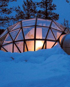 Snuggle into a glass igloo at Hotel Kakslauttanen in Finland