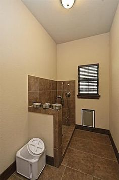 This mudroom has a dog door to the yard and a doggie shower!