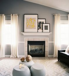 ...and AFTER! To take advantage of the natural light and sloped ceiling, the walls were painted in Benjamin Moore's Silver Half Dollar paint.   Windows were redressed in natural linen/cotton drapery from West Elm.  Click to see the full makeover! Living Rooms, Frame, Mantel, Fireplaces, Grey Wall, Gray Walls, Paint Colors, Live Room, Mantles