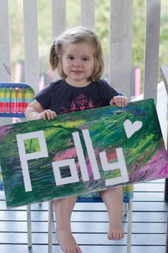 Painters tape canvas with name, fun craft! Have kids paint over babies name and use in nursery.