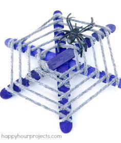 Popsicle stick spiderwebs kids Halloween craft at www.happyhourprojects.com