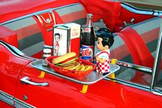 looks like burgers and fries at the Big Boy drive in restaurant....was the 'car hop' on roller skates?