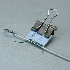 Clever technique using skewer to make a wire spiral binding for a mini book #coil #bindings #techniques
