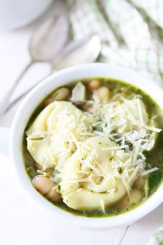 Spinach Artichoke Pesto Tortellini Soup Recipe on twopeasandtheirpod.com This tortellini soup is full of flavor and is so easy to make! #soup #recipe