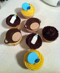 Various different decorations like Monkey baby shower cupcakes, bottle baby shower cupcakes