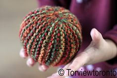 knit ball -- it starts as a rectangle of hand knitting . . . fun just to try this technique!  I love it!