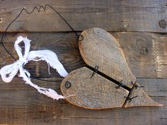 heart pieced from barnwood - rustic - held together with wire, could incorporate barbed wire frame (probably won't), hang from wire, simple torn fabric bow, i like this one for outdoor decor, might hang on the gate to the chicken yard or who knows where :)