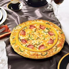 Domino's, South Korea's Triple Cheese Pizza. What You Get: Emmental, Camembert, and Cheddar cheeses are placed between  three thin crust doughs and topped with potato mousse.