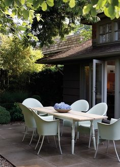 Pretty Garden Patio    Contemporary designer chairs elevate an inexpensive Ikea table.