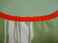 Finishing curved edges is tricky business; you cant just turn and hem as you would a straight edge...