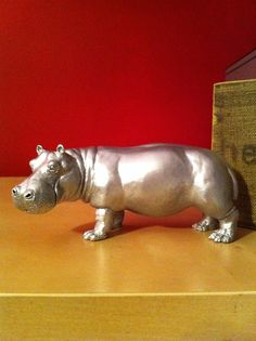 Silver spray painted toy hippo