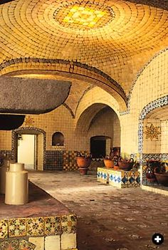 Kitchen inspiration. like the yellow.   In Puebla, the second city of Mexico's colonial era, the kitchen of the early-18th-century convent of Santa Rosa uses bench stoves, tile, vaults and domed ceilings in a fashion that almost replicates those of al-Andalus and North Africa. mexican kitchen, interior design, cocina mexicana, hacienda, kitchen colors, mexico, tile, ceilings, dome ceil