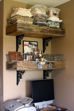 Old wood crates + iron brackets = shelves! thinking about removing large mirror and doing this over toilet with a smaller framed mirror