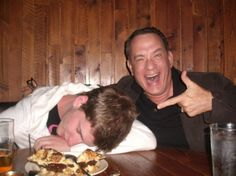 Tom Hanks grabs a random drunk guy's phone for a photo op. I wonder how he felt the next morning when he saw this.- Tom Hanks is the greatest.
