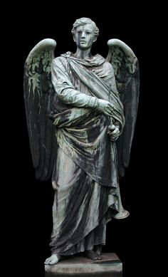 I love this one because it's a male angel. Most of the cemetery angel statues you see are female.