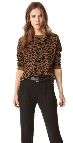 Patterned in abstract leopard print, this wool A.L.C. sweater offers an exotic take on a timeless silhouette.