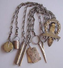 A chatelaine was an ornamental clasp, from which hung many useful tools: scissors, needlecase, keys, etc.
