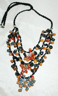 Hand Made Mexican Necklace with 100's of tiny Ceramic Pottery Cups Charms with 3 tiers.on black braided cord  There are also some corn metate's and round mortar bowls .    It has a drop length of...